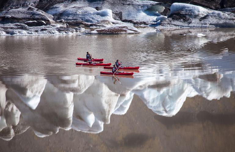 Kayak in Sólheimajökull Glacier Lagoon