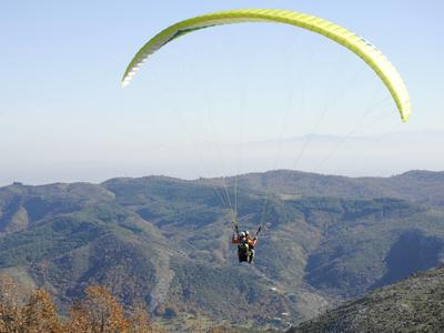 Tandem paragliding flight above the Plastiras lake
