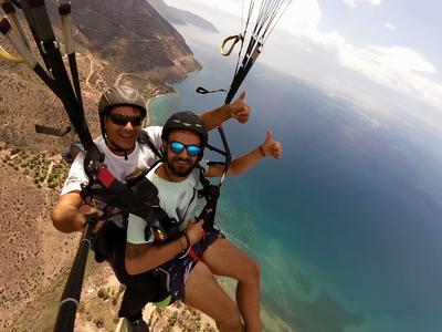 Tandem paragliding flight in the Gulf of Itea at 2000m, Greece