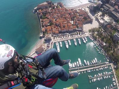 Tandem paragliding flight over the Old Town of Budva, Montenegro