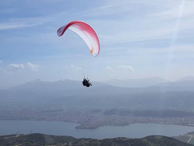 Tandem paragliding flight over Ioanina Lake, Greece